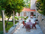 Outside dining area in park of this exclusive Dubrovnik villa
