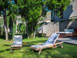 Sunbeds in garden of the five star villa in Dubrovnithe k