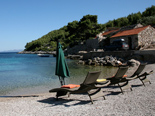Pebble beach in the bay in front of the five star luxury villa on the island of Korcula in Croatia