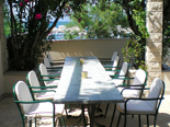 Outside terrace with table in holiday villa with pool in Mirca on Brac Croatia