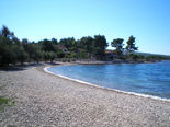 Beach in front of the holiday villa with pool in Mirca on Brac Croatia