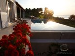 Morning sun reflecting in the pool in luxury holiday villa on island Brac in Dalmatia in Croatia