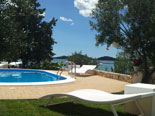 Sun beds on the pool in luxury villa in Dalmatia in Croatia