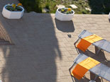 Sun deck with sun beds in front of the villa in Šibenik region