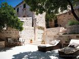 Sunbeds on the outside terrace in luxury Dalmatian villa for rent in Hvar in Croatia