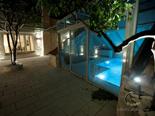 Outside terrace with indoor pool in luxury Dalmatian Hvar rental villa in Croatia