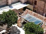 View on terrace and pool house in Hvar luxury rental villa in Dalmatia Croatia