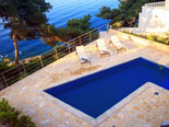 The pool of the modern Dalmatian seafront villa with pool on Brac Island in Split region