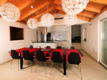Dining room in the modern Dalmatian seafront villa with pool on Brac Island in Split region