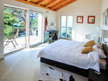 Bedroom in the modern Dalmatian seafront villa with pool on Brac Island in Split region