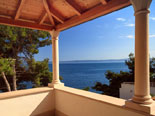 Terrace and the view from the modern Dalmatian seafront villa with pool on Brac Island in Split region