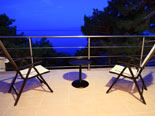 Outside terrace in the modern Dalmatian seafront villa with pool on Brac Island in Split region