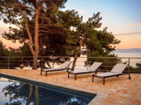 Outside of the modern Dalmatian seafront villa with pool on Brac Island in Split region