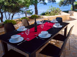 Outside dining terrace in front of the Dalmatian villa with pool on Brac Island in Split region