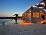 Pool area of the luxury seafront villa on Dalmatian island of Korčula during sunset