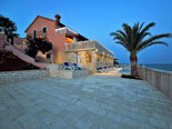 Big terrace and view on the west side of this seafront luxury Korčula villa by night