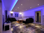 Nighttime lighting in the living room which is located on the second floor of this luxury villa on Korčula island