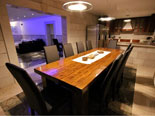 Dining table with kitchen in the background in this seafront Dalmatian luxury villa