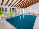 Indoor swimming pool is located in northern part of the garden