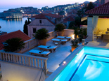 The white stone luxury villa with view at  Dubrovnik at dusk
