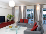The living area is equipped with TV, modern sofas...