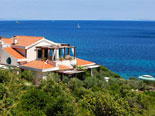 The villa is located on the edge of the sea