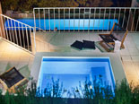 Jacuzzi and the pool by night in this design villa in Dubrovnik