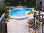 The pool area in traditional Dalmatian style holiday villa in Milna on Brac island in Croatia