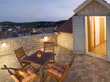 The upper terrace in Dalmatian traditional style holiday villa in Milna on Brac island in Croatia