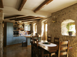 Dining room and kitchen in Dalmatian holiday villa in Milna on Brac island in Croatia