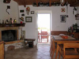 Traditionally decorated dining area with fire place in the house for rent on Brač Island