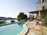 View from the pool of the old Dalmatian stone villa in Sumartin on Island of Brač Croatia