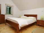 Bedroom in the old Dalmatian stone villa in Sumartin on Island of Brač Croatia