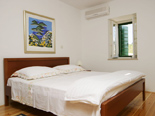 Bedroom in the old Dalmatian stone villa in Sumartin on Island of Brač Croatia