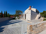 Outside of the Dalmatian stone holiday rental villa in Sumartin on Brač Island