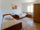Bedroom in Dalmatian holiday villa with pool for rent in Sumartin on Brač Island