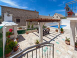 Pool and leisure area in four star holiday rental villa in Povlja on Brač Island in Dalmatia