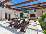 Outside dining with BBQ in four star holiday rental villa in Povlja on Brač Island in Dalmatia