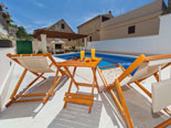 Leisure area at the pool of the four star holiday villa for rent in Povlja on Brač Island in Dalmatia
