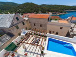 View on the pool and outside dining of the four star holiday villa for rent in Povlja on Brač Island in Dalmatia