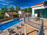 Outside palm tree rental villa with pool in Sumartin on Brač Island in Dalmatia in Croatia