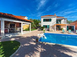 Pool and summer dining house in rental villa in Sumartin on Brač Island in Dalmatia in Croatia
