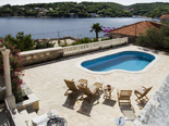 The view on the pool and the bay in Dalmatian holiday villa for rent in Sumartin on Brac in Split region
