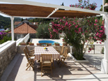 Outside dining area in Dalmatian holiday villa for rent in Sumartin on Brac in Split region