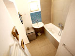 En-suite bathroom of the downstairs double room with exterior entrance in Hvar holiday house
