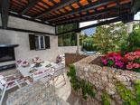 Outdoor dining terrace in villa in Baska voda in Croatia