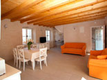 Dining and living room in the traditional old stone house for rent in Omiš in Dalmatia