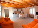 Another view on dining room, living room and kitchen in background in holiday house for rent in Omiš