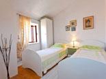 Twin bedroom in Sutivan holiday villa