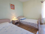 Another twin bedroom in Sutivan holiday villa